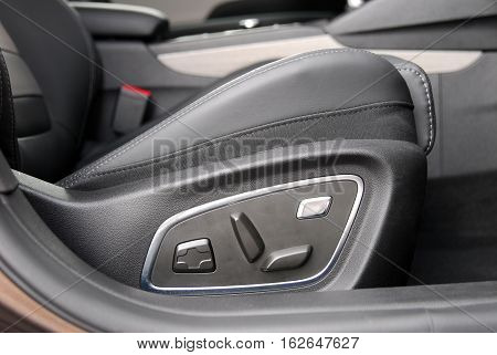 Buttons for adjusting seat position. Car interior detail