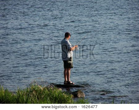 Fisherman In Evening Sun