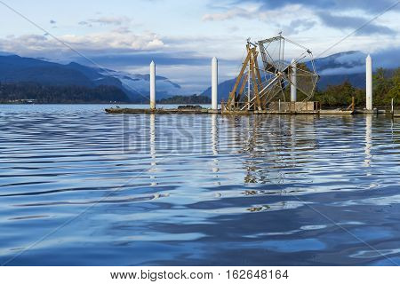 Fish Wheel on the Columbia River Gorge Washington. A fish wheel is a device for catching fish which operates much as a water-powered mill wheel.