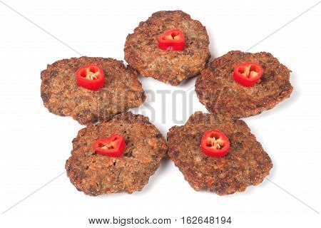 liver pancakes or cutlets with chili pepper isolated on white background.