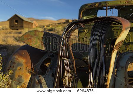Old Abandoned Vehicle In The Nevada Desert At Sunrise.