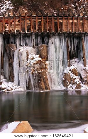 Old Logging Water Flumes With Icicles Forming From Leaks. Along The Truckee River Near The Californi
