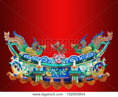 Chinese Phoenix Statue On The Red Background.