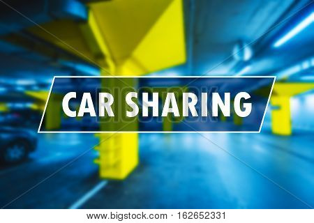 Car sharing or carsharing concept for model of vehicle rental for short periods of time blur underground garage parking lot in background