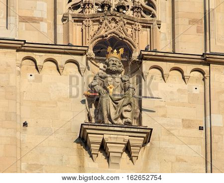 Zurich, Switzerland - 19 December, 2016: sculpture of Charles the Great on the tower of the Grossmunster Cathedral. Charles the Great, also known as Charlemagne, was the king of Franks, who united a large part of Europe during the early Middle Ages.