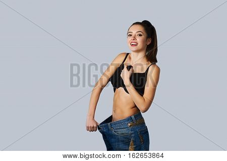 beautiful young woman with big jeans weight loss