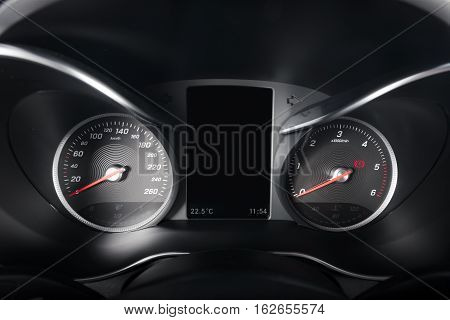Modern sport car interior dashboard details, km/h and rpm