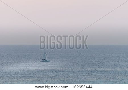 Sailboats On Sea Navigating Under The Sunset