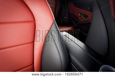 Modern luxury red perforated leather sport car interior details