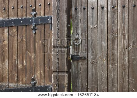 Wooden gate with bolt metal handle and chain