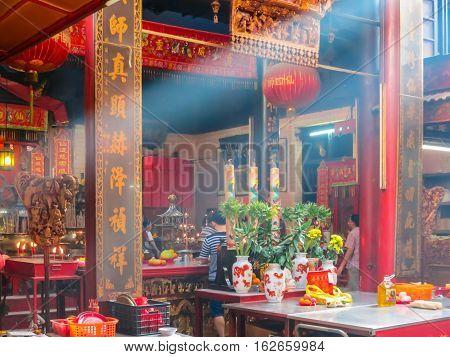 KUALA LUMPUR, MALAYSIA - JANUARY 12, 2014: Interior of the ancient Temple. Chinatown, Kuala Lumpur, Malaysia