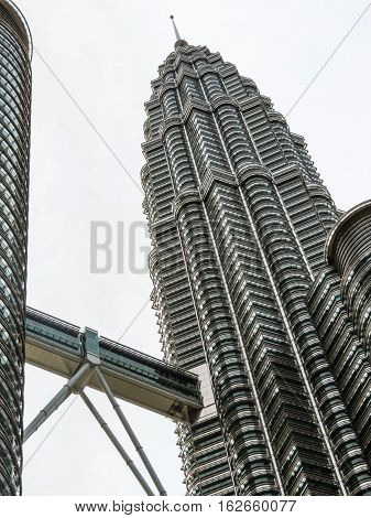 KUALA LUMPUR, MALAYSIA - JANUARY 12, 2014: One of Petronas Twin Towers. Kuala Lumpur, Malaysia