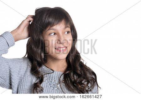 close up portrait of brunette girl on white background