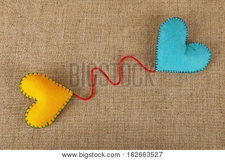 Two Felt Craft Hearts, Yellow And Blue On Canvas