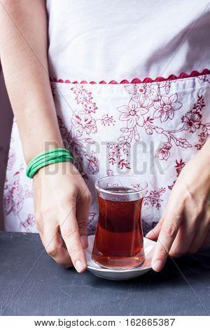 A glass of black tea, traditional turkish black tea