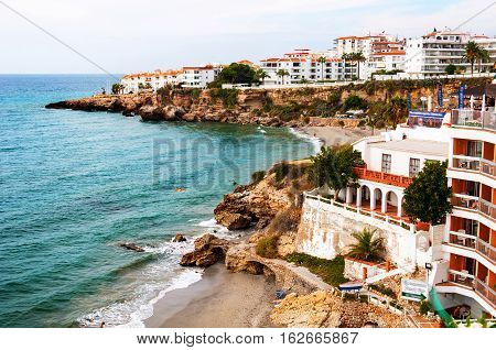 Nerja Spain. Little touristic town Nerja in Costa del Sol Andalusia Spain. It has many restaurants bars and cafes. Aerial view of the beach