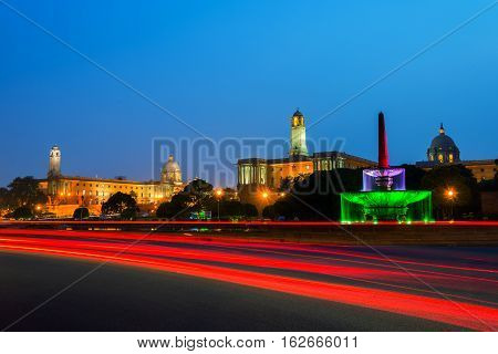 Delhi India. Illuminated Rashtrapati Bhavan an Parliament building in Delhi India. Car traffic trail lights. Dark sunset sky