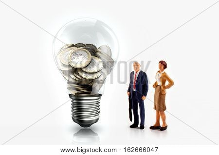 Miniature people in front a light bulb with Euro coins inside