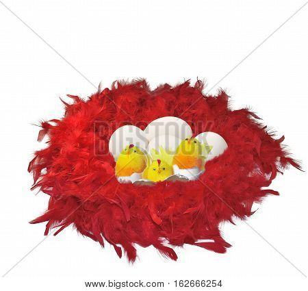 Red fluffy nest from feathers with funny chicks toys eggs and eggshell close up isolated on white background - festive Easter background with copy space for text