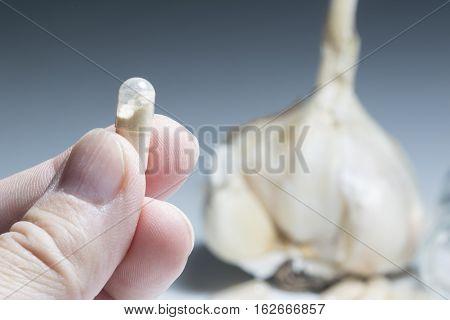 Man takes garlic capsule flu virus protection