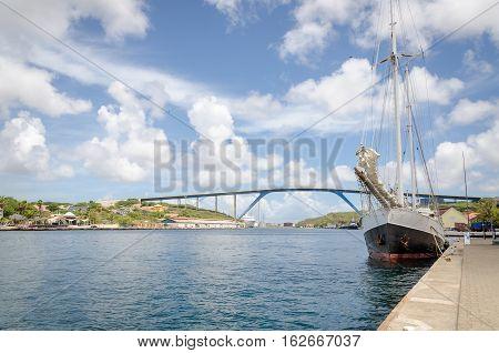 Willemstad, Curacao Handelskade Wharf With Queen Juliana Bridge
