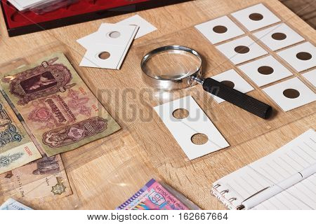 Different Collector's Coins And Banknotes
