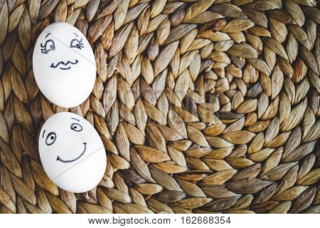 concept human relationships and emotions eggs flirtation on mat top view