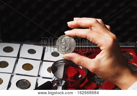 Woman Looks At The Dollar Coin