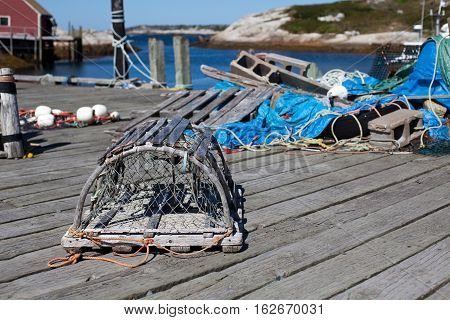 Nova Scotia Canada - september 28 2015: Old style lobster traps on a wharf at Peggy's Cove Nova Scotia Canada