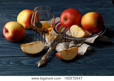 Apple Cider In Wine Glass With Cinnamon Sticks And Fresh Apples On Wooden Background
