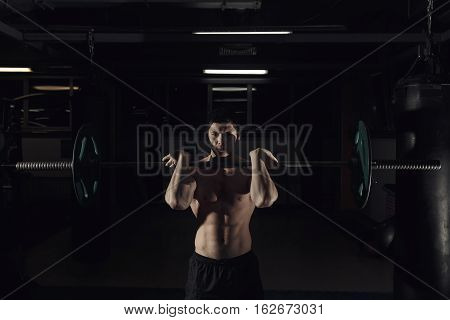 The Clean And Jerk Exercise - Young Man Doing Weightlifting Workout At The Gym.