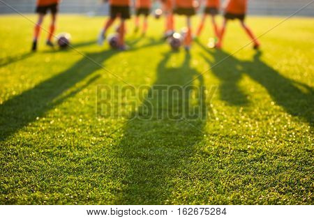 Blurred Soccer Field at School. Young Soccer Players Training on Pitch. Soccer Stadium Grass Background
