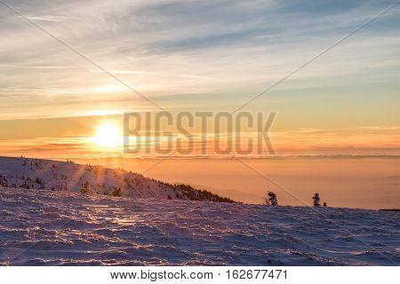 Sunset At Winter Mountains
