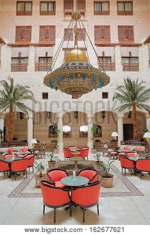 PETRA, JORDAN - MARCH 12, 2016: The magnificent courtyard atrium of the Movenpick Hotel located at the entrance of the site