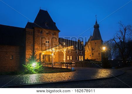 Medieval Doorwerth Castle   on the river Rhine near the city of Arnhem late in the evening, Netherlands.