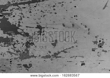 Black and white distressed wooden painted texture. Monochrome texture with obsolete paint. Painted distressed shabby surface closeup. Cracked paint close-up image. Weathered wooden texture background