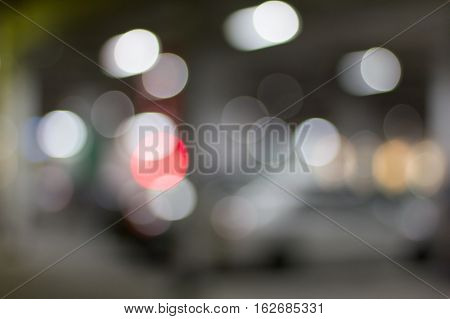 De focused/blur image of city at night. A man crossing the road. De focused blurred urban abstract traffic background.