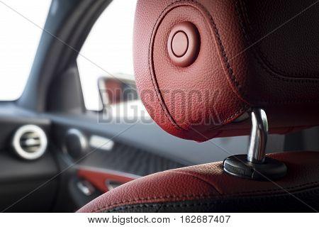 Modern sport car interior with red leather passenger headrest