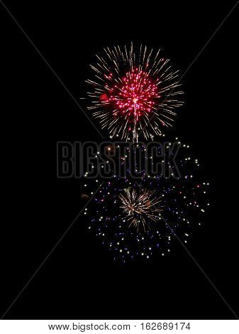 Brightly Colorful Fireworks isolated black background. New Year celebration fireworks.