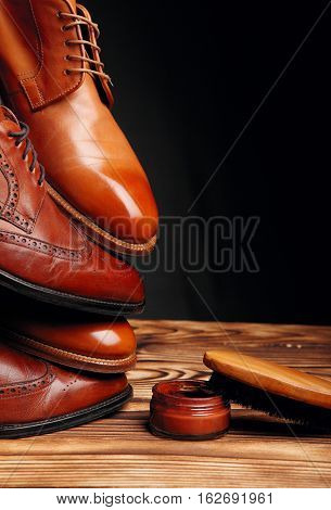 Four Toes One On One Of Brown Shoes Brogues And Derby On The Wooden Table.brush And Cream.shoes Shin