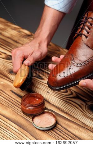 Shoes Master Man Polishing Leather Shoes With Brush