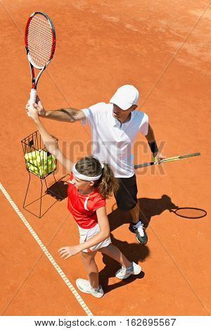 Coach With Junior Female Tennis Player