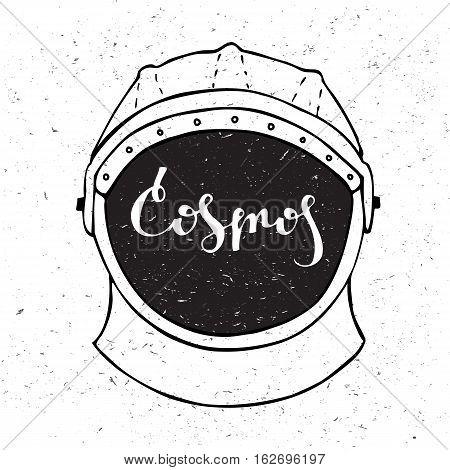 Astronaut helmet with inscription cosmos in the center. Lettering.