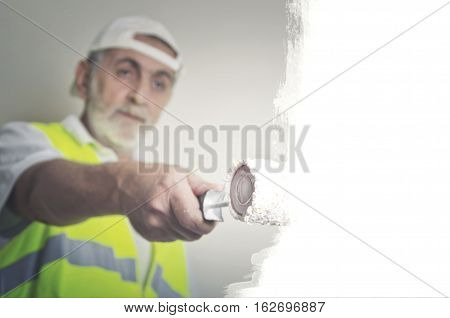 Painting decoration repair building and home concept - close up of male holding painting roller