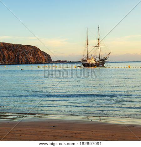 touristic ship on los cristianos coast in tenerife