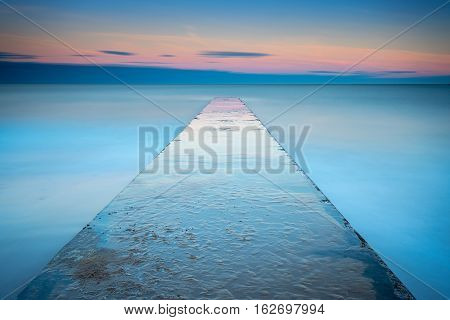 Long Exposure of Blyth Beach Jetty, giving a minimalistic view of it  reaching out into the North Sea at Blyth in Northumberland, at sunset