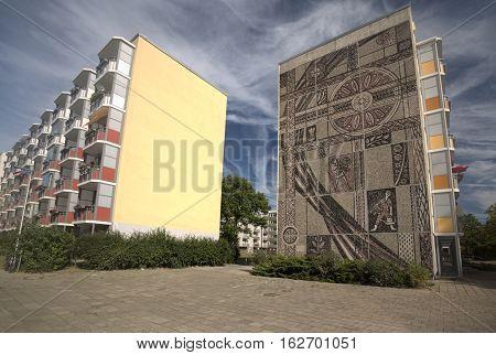 Greifswald, Germany - Sep 09 2016 : East-german Plattenbauten In Greifswald With Wall Decoration By