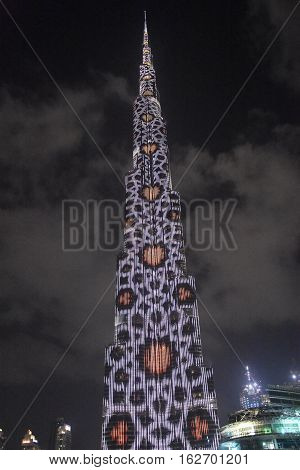 DUBAI, UAE - DEC 9: The LED lights show at Burj Khalifa in Dubai, UAE, as seen on Dec 9, 2016. The show titled Ascension was created by London-based Yusuke Murakami and Tangent Design and Invention.