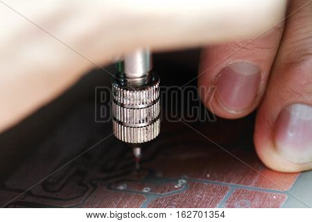 Use Mini Drill To Broach On Printed Circuit Boards.