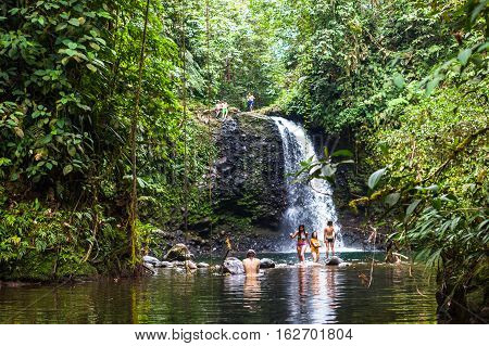 Pedro Vicente Ecuador - August 28 2015: Group of unidentified young people taking a bath in the waterfall El Encuentro in Pedro Vicente.